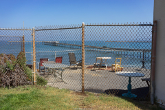 michael_prais_Ocean_Beach_-_Fence_Chairs_Pier