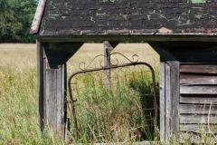 Broken Gate on Farm Building